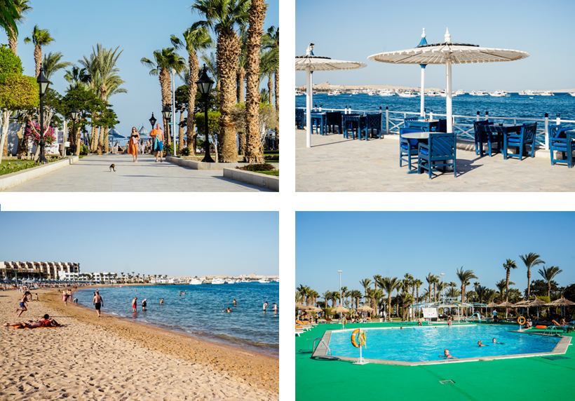 Gepflegte Palmenpromenade, Beach-Restaurant, Sand-Strand & Pool-Area im Grand Hotel Hurghada